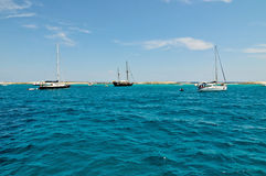 Sailing boats near the coast of the Formentera island royalty free stock photos