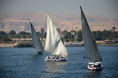 Sailing boats on the Nile. Ferry tourists over the Nile in the valley of the dead. Egypt, Luxor Royalty Free Stock Image