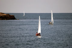 Sailing boats out to sea stock images