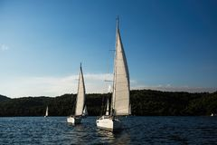 Sailing boats participate in yachting regatta in the Aegean Sea. royalty free stock images