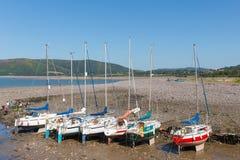 Sailing boats Porlock Weir beach Somerset on the Exmoor Heritage coast England UK in summer. Yachts Porlock Weir beach Somerset on the Exmoor Heritage coast Royalty Free Stock Photography