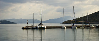 Sailing boats in port or harbour in Greece. Sailing boats in Achillio port in Greece stock photography
