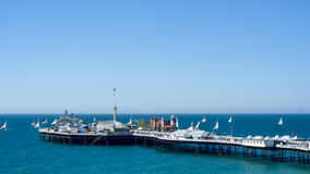 Sailing boats in a regatta around Brighton Pier, Southern England Royalty Free Stock Images