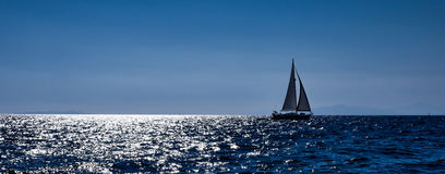 Sailing boats in the sea close to the coast Royalty Free Stock Images