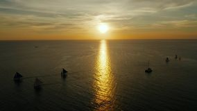 Sailing boats on the sea at the sunset at Boracay island,Philippines. Sailboat against a beautiful sunset. Sailing with a beautiful sunset stock video footage