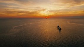 Sailing boats on the sea at the sunset at Boracay island,Philippines. Sailboat against a beautiful sunset. Sailing with a beautiful sunset stock video