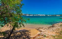 Sailing boats at seaside of Porto Colom on Mallorca. View of Porto Colom harbour small town on Majorca, Spain Balearic Islands Stock Photo