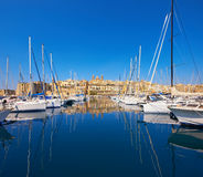 Sailing boats on Senglea marina in Grand Bay, Valetta, Malta. On a bright day Stock Photography