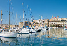 Sailing boats on Senglea marina in Grand Bay, Valetta, Malta. On a bright sunny morning Royalty Free Stock Photos
