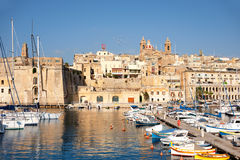 Sailing boats on Senglea marina in Grand Bay, Valetta, Malta. On a bright sunny morning Stock Images
