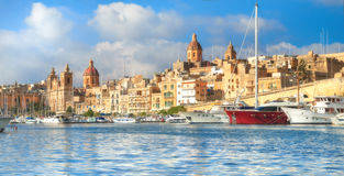 Sailing boats on Senglea marina in Grand Bay, Valetta, Malta. On a bright sunny morning Royalty Free Stock Images