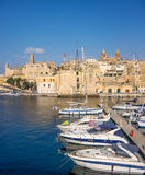 Sailing boats on Senglea marina in Grand Bay, Valetta, Malta. On a bright sunny morning, panoramic image Royalty Free Stock Images