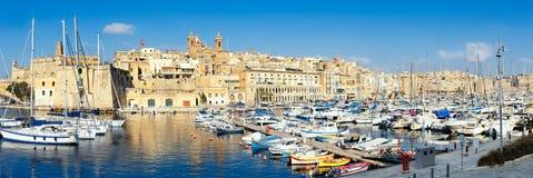 Sailing boats on Senglea marina in Grand Bay, Valetta, Malta. On a bright sunny morning, panoramic image Stock Photography