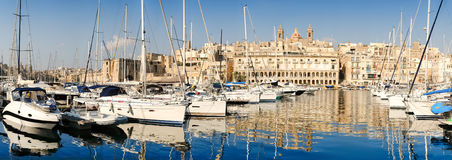 Sailing boats on Senglea marina in Grand Bay, Valetta, Malta. On a bright sunny morning, panoramic image Royalty Free Stock Photography