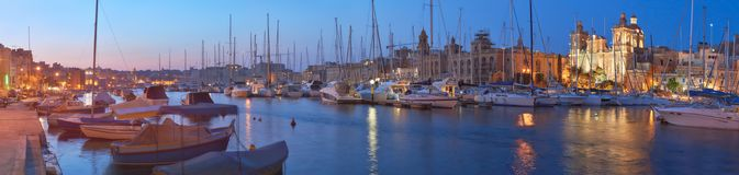 Sailing boats on Senglea marina in Grand Bay, Valetta, Malta, at. Sailing boats on Senglea marina in Grand Bay, Valetta, Malta in the evening, panoramic image Stock Photos