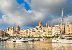 Sailing boats on Senglea marina in Grand Bay, Valetta, Malta. On golden afternoon Royalty Free Stock Photos