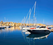 Sailing boats on Senglea marina in Grand Bay, Valetta, Malta. On golden morning Royalty Free Stock Photo