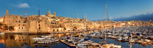 Sailing boats on Senglea marina in Grand Bay, Valetta, Malta, at. Sailing boats on Senglea marina in Grand Bay, Valetta, Malta, on a quiet evening. panoramic Royalty Free Stock Photography