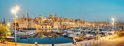 Sailing boats on Senglea marina, Valetta, Malta. Panorama wth sailing boats on Senglea marina in Grand Bay, Valetta, Malta, on a quiet evening. This image is Stock Photography