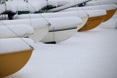 Sailing boats in the snow. On Brighton beach Stock Images