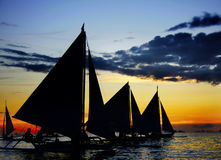 Sailing boats at sunset Stock Photo