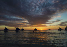 Sailing boats at sunset boracay tropical island philippines Royalty Free Stock Image