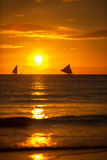 Sailing boats on sunset Stock Images
