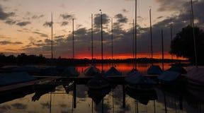 Sailing boats at sunset Stock Images