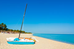 Sailing boats and umbrellas on a beach in Cuba Royalty Free Stock Image