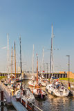 Sailing boats waiting in a sluice before entering the IJselmeer Royalty Free Stock Photo