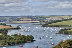 Sailing boats and yachts in Devon. Bay with fields in the background Royalty Free Stock Photo