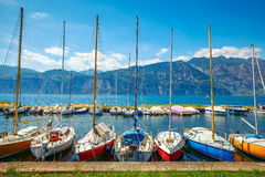 Sailing boats yachts on lake with mountains Royalty Free Stock Photos