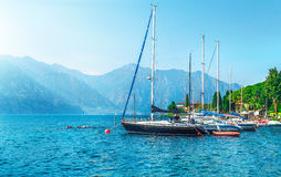 Sailing boats yachts on lake with mountains Royalty Free Stock Image