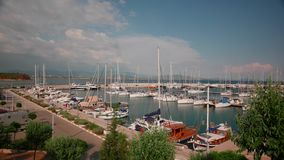 Sailing boats and yachts in a marina stock video