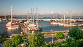 Sailing boats and yachts in a marina in a windy stock footage