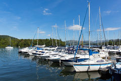 Sailing boats and yachts with masts in a row on a lake with beautiful blue sky Stock Photography
