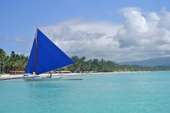Sailing Borocay. A traditional paraw sailing boat on on Boracay Island, Philippines royalty free stock photography