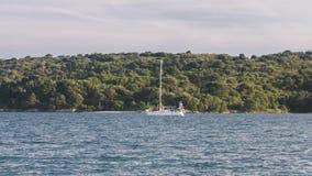 Sailing bot at the shore stock footage