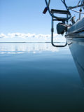 Sailing on a calm day. Sailboat against the calm sea on a beautiful and peaceful day royalty free stock photos