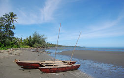 Sailing canoe at beach Papua New Guinea. Sailing canoe at ocean beach in Papua New Guinea Stock Photos