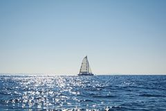 Sailing catamaran in the Aegean sea, Greece. View of a sailing catamaran in the Aegean sea, Greece stock photography