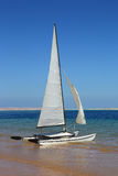Sailing catamaran on beach Royalty Free Stock Photo