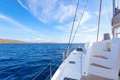 Sailing catamaran. On board view of a sailing catamaran cruising the aegean sea, Greece Royalty Free Stock Images