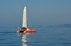 Sailing catamaran in the Ionian Sea. During the 2012 summer Royalty Free Stock Images