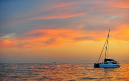 Sailing catamaran at the ocean at the coast of South Africa at sunrise. Stock Photography