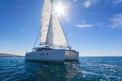 Sailing catamaran sail the Aegean sea Stock Photos