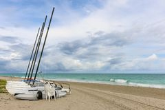 Sailing catamarans without sails on the beach, Cuba, Varadero Stock Photo