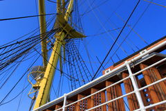Sailing. Central mast of a ship and safety railing stock image