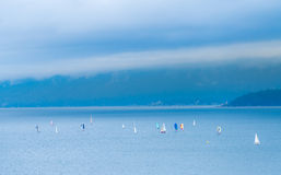 Sailing in cloudy day Stock Photos