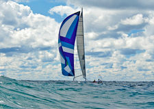 Sailing with a colorful spinnaker. Sailboat with a spinnaker on high seas Royalty Free Stock Photography